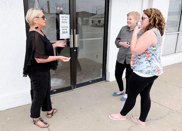 Don Knight | The Herald Bulletin<br /> From left, Tami Blevins talks to Barbara Biele and Rachel Slagle who are excited to see Farm Society, a farm to table restaurant, open in downtown Anderson.
