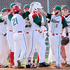 Don Knight | The Herald Bulletin<br /> Anderson pitcher Jacob Morris is greeted by his teammates at home plate after hitting a two run home run as the Indians hosted Muncie Central at Memorial Field on Tuesday.