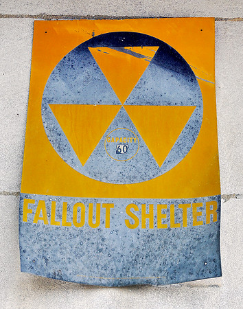 John P. Cleary | The Herald Bulletin<br /> An old fallout shelter sign is still hanging on the front of Lambert's Music Center building at 14th & Meridian Street in Anderson.