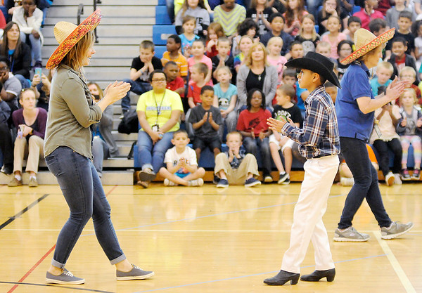 Don Knight   The Herald Bulletin<br /> First grade teacher Kristen Bowen dances the La Raspa with Raymundo Cruz as the Anderson Folklórico Dance Troupe performs for students at Eastside Elementary for Cinco de Mayo on Friday. The holiday commemorates the Mexican Army's defeat of the French at the Battle of Puebla in 1862.