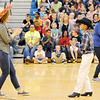 Don Knight | The Herald Bulletin<br /> First grade teacher Kristen Bowen dances the La Raspa with Raymundo Cruz as the Anderson Folklórico Dance Troupe performs for students at Eastside Elementary for Cinco de Mayo on Friday. The holiday commemorates the Mexican Army's defeat of the French at the Battle of Puebla in 1862.