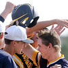 Don Knight | The Herald Bulletin<br /> Coleson White's teammates meet him at homeplate after he hit a home run on Thursday.