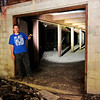 Don Knight | The Herald Bulletin<br /> Tim Bowers stands at the entrance of a former fallout shelter in Anderson.