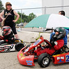 Don Knight | The Herald Bulletin<br /> Grahm Kriser stays dry under an umbrella while waiting for the Kids Kart feature to start during the 24th annual Mayor's Cup Grand Prix at Mounds Mall on Saturday.