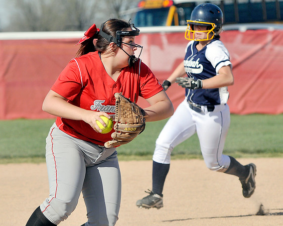 John P. Cleary   The Herald Bulletin  <br /> Frankton's third baseman Maddie Granger sets to throw to first as the Shenandoah runner is moving with two outs.