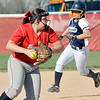 John P. Cleary | The Herald Bulletin  <br /> Frankton's third baseman Maddie Granger sets to throw to first as the Shenandoah runner is moving with two outs.