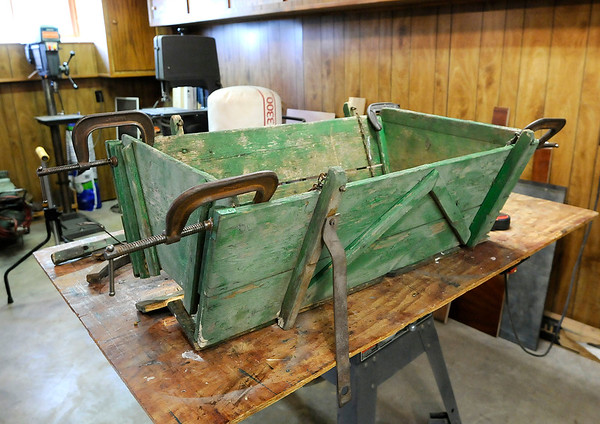 Don Knight | The Herald Bulletin<br /> Ron Carey is restoring this goat cart for the Madison County Historical Society.