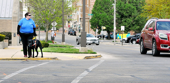 John P. Cleary   The Herald Bulletin<br /> Kassie Lemons waits to cross Central Avenue with her guide dog Kingsley.