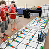 Don Knight | The Herald Bulletin<br /> From left, Blayke Lindsey and Max Barr demonstrate the Frankton Cyborgs robot on Friday. The team recently competed in the World Championships in Louisville.