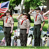 John P. Cleary | The Herald Bulletin<br /> Members of Boy Scout Troop 301 salute as the colors of our country and each military branch was raised during the annual Memorial Day Remembrance Service at Maplewood Cemetery.