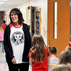 John P. Cleary | The Herald Bulletin  <br /> Cheryl Oldham, an instructional assistant at Elwood Elementary School, was named a Max Beigh Award winner. Here Oldham reacts with other students and faculty as she walks these kindergarten students to the music room.