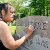 John P. Cleary | The Herald Bulletin<br /> Connie Roberts highlights the lettering on her mother's marker Thursday at Maplewood Cemetery.