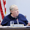 Don Knight | The Herald Bulletin<br /> Councilman Greg Graham answers a question from Councilman Ollie Dixon about an amendment prohibiting people from keeping animals in abandoned homes or lots that was added to an ordinance updating the city's animal control ordinance on Thursday.