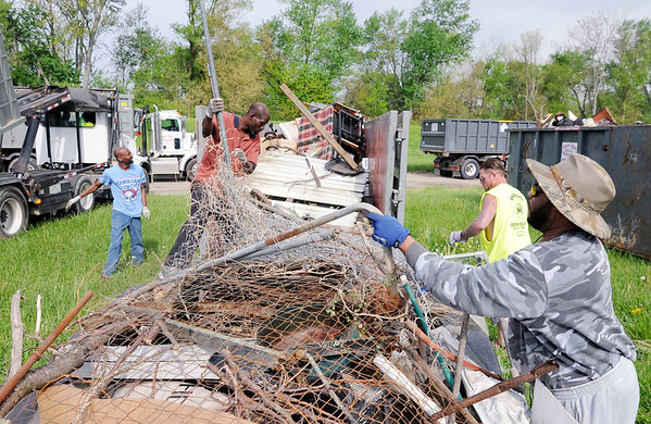 Don Knight | The Herald Bulletin<br /> From left, John White, Donnie Cole, Toby Belcher and Robby Peal unload a trailer full of items picked up during the Citywide Cleanup on Saturday.