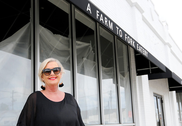 Don Knight   The Herald Bulletin<br /> Tami Blevins is working to open Farm Society, a farm to table restaurant, in downtown Anderson. The building needed to be rewired which has delayed the opening.