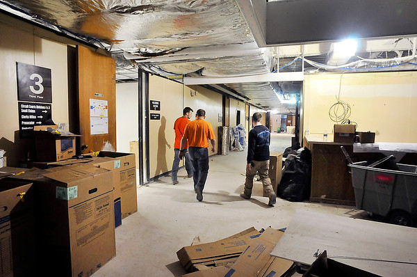 John P. Cleary | The Herald Bulletin<br /> The remodeling and asbestos removal work at the Madison County Government Center is over budget by a minimum of $623,500. With some work being two to three weeks behind schedule, consultants say the third and fourth floor offices will be completed by July 1.