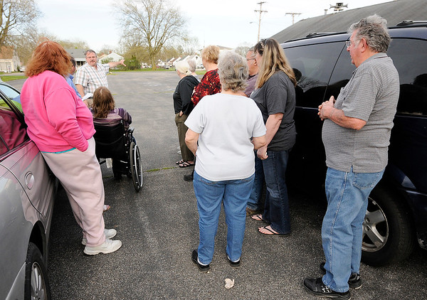 Don Knight | The Herald Bulletin<br /> Congregants at Cornerstone Ministries meet with reporter Stu Hirsch on Tuesday. They say their pastor is selling the church to recoup back pay he claims he is owed.