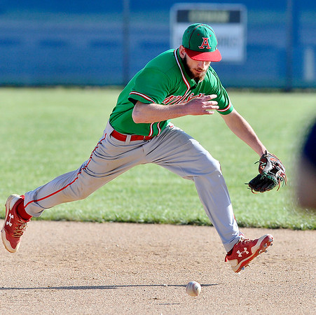John P. Cleary   The Herald Bulletin<br /> Anderson's second baseman Brayden Waymire runs down a grounder to get the third out of the third inning leaving two Raiders on base.