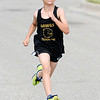 Don Knight | The Herald Bulletin<br /> Carter Scott, 8, is the first to cross the finish line during the St. Vincent-YMCA Kidz Marathon at Anderson University on Saturday.