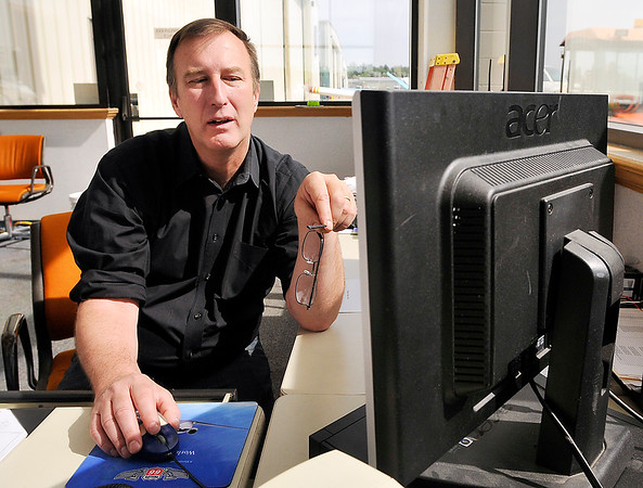 John P. Cleary | The Herald Bulletin<br /> Brian McMillen, manager of the Anderson Municipal Airport, uses the new aviation computer software that shows the location of every aircraft  in the country that is equipped with the new technology.