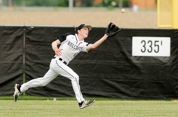 Don Knight | The Herald Bulletin<br /> Lapel's Justin Engle catches a fly ball in the outfield as the Bulldogs hosted the Pendleton Heights Arabians on Tuesday.
