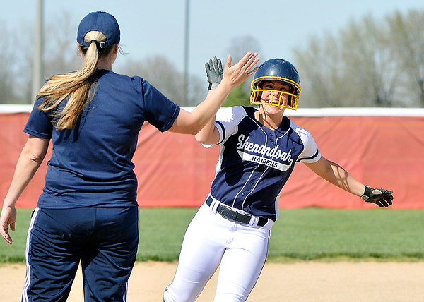 John P. Cleary | The Herald Bulletin  <br /> Shenandoah's Bridget Lohrey as a big smile as she gets a high-five from head coach Alison Merritt after hitting a two-run homer in the first inning.