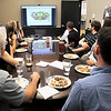 John P. Cleary | The Herald Bulletin<br /> The krM Architecture design team gets together each Friday over lunch to critique projects they are working on.