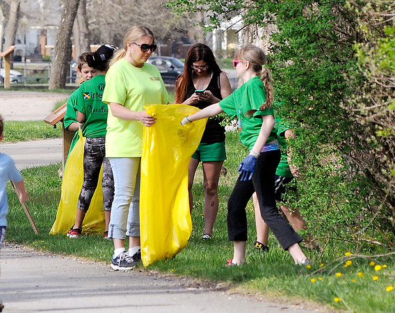 """John P. Cleary   The Herald Bulletin  <br /> Pendleton school students did volunteer work as part of first """"Pendleton's Day of Giving"""" Wednesday. Here a group was picking up trash along the trails in Falls Park."""