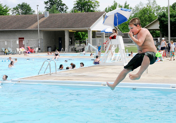 Don Knight   The Herald Bulletin<br /> Ricky Ripberger jumps off the diving board at the Alexandria pool on Tuesday.<br /> The pool is open for the season. Entrance is $4 and the pool is open daily from noon to 4 p.m. except for 4-H Fair week when it will be closes. The pool is also home to the Anderson Swim Club.