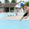Don Knight | The Herald Bulletin<br /> Ricky Ripberger jumps off the diving board at the Alexandria pool on Tuesday.<br /> The pool is open for the season. Entrance is $4 and the pool is open daily from noon to 4 p.m. except for 4-H Fair week when it will be closes. The pool is also home to the Anderson Swim Club.