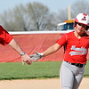 John P. Cleary | The Herald Bulletin  <br /> Frankton's Aleyah Rastetter gets five from Frankton head coach Jeremy Parker as Rastetter rounds third base after hitting a two-run homer in the first inning.