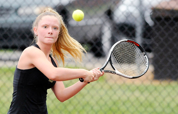 Don Knight   The Herald Bulletin<br /> Alexandria's McKenzie Adams returns a volley to Lapel's Bailey Baxter as she takes a 4-1 lead in the No. 3 singles match before rain postponed the sectional tennis final at Highland Middle School on Friday.