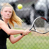 Don Knight | The Herald Bulletin<br /> Alexandria's McKenzie Adams returns a volley to Lapel's Bailey Baxter as she takes a 4-1 lead in the No. 3 singles match before rain postponed the sectional tennis final at Highland Middle School on Friday.