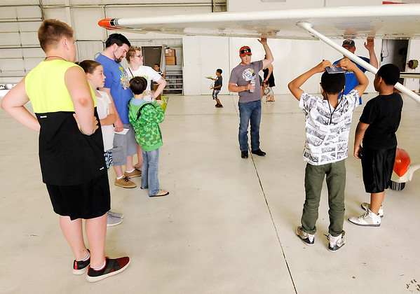 Don Knight   The Herald Bulletin<br /> Ricky Robertson walks kids through a pre-flight inspection during the Young Eagles event hosted by the Experimantal Aircraft Association at the Anderson Airport on Saturday.