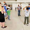 Don Knight | The Herald Bulletin<br /> Ricky Robertson walks kids through a pre-flight inspection during the Young Eagles event hosted by the Experimantal Aircraft Association at the Anderson Airport on Saturday.