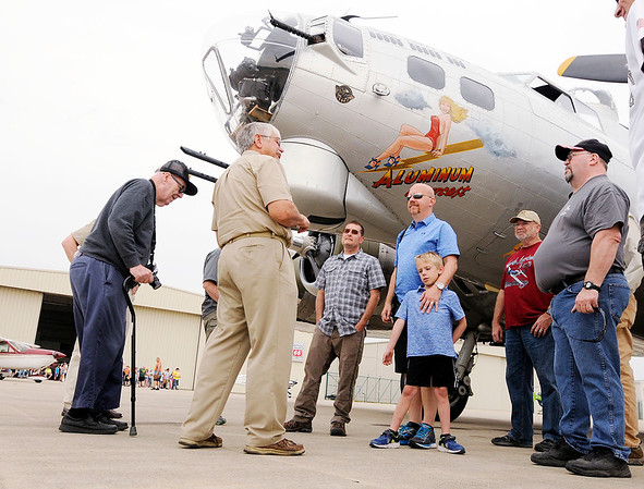 Don Knight   The Herald Bulletin<br /> Passengers riding on the B-17 Bomber Aluminum Overcast receive a briefing from their pilot before boarding the historic aircraft at the Anderson Airport on Saturday.