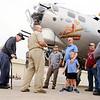 Don Knight | The Herald Bulletin<br /> Passengers riding on the B-17 Bomber Aluminum Overcast receive a briefing from their pilot before boarding the historic aircraft at the Anderson Airport on Saturday.