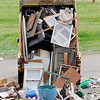 Don Knight | The Herald Bulletin<br /> A street department truck dumps items picked up from city residents at Athletic Park where it was loaded into dumpsters during the Citywide Cleanup on Saturday.