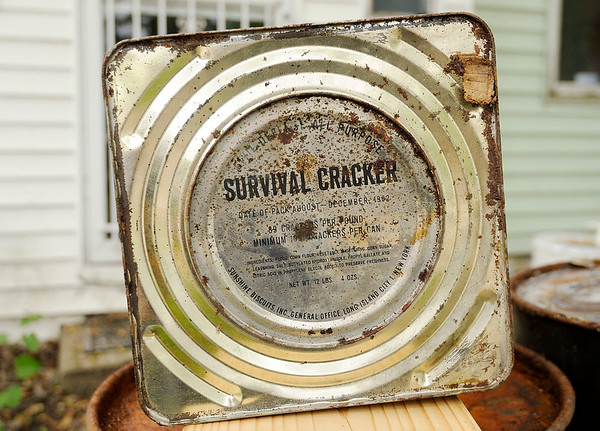 Don Knight   The Herald Bulletin<br /> Tim Bowers has a tin of survival crackers he found in a fallout shelter.