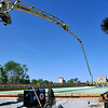 John P. Cleary | The Herald Bulletin<br /> Concrete was pumped through a giant boom to reach the center of the west-bound lanes of the Eisenhower Bridge Monday as workers started to pour the bridge surface.