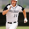 Don Knight | The Herald Bulletin<br /> Lapel's Levi Frazier runs to third on a triple as the Bulldogs hosted the Sheridan Blackhawks on Friday.