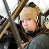 Don Knight | The Herald Bulletin<br /> Allison Fleener, 17, prepares to exit Jeff Moore's bi-plane during the Young Eagles event at the Anderson Airport on Saturday. There were 114 kids who took advantage of the Experimental Aircraft Association's offer for a free flight.