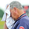 John P. Cleary | The Herald Bulletin<br /> This umpire was trying to cool down between innings as he was working this Memorial Day at Frankton for the 2A baseball sectional championship game.