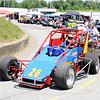 Don Knight | The Herald Bulletin<br /> Linda Bloom uses an ATV to push her husband onto the track during practice for the Little 500 at the Anderson Speedway on Wednesday. The two met at a race track and have been married 45 years.