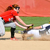 John P. Cleary | The Herald Bulletin  <br /> Frankton's shortstop, Laikyn Lowe, puts the tag on Shenandoah's Emily Olsen as she attempts to steal second base in the first inning of their softball game.