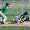John P. Cleary | The Herald Bulletin<br /> Shenandoah's Gabe Young slides into third with a triple as the ball pops up in front of Anderson's third baseman Jacob Morris on the relay throw in the second inning.