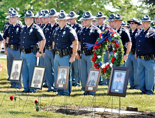 John P. Cleary | The Herald Bulletin<br /> The Indiana State Police Pendleton District held its annual memorial service Thursday remembering the 46 ISP employees who lost their lives in the line of duty including these troopers from the Pendleton District.