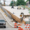 John P. Cleary | The Herald Bulletin<br /> Work continues on the Eisenhower Bridge project as workers start to form up the barrier for the sidewalk for the westbound lanes after the rest of the concrete for the decking had been poured last week.