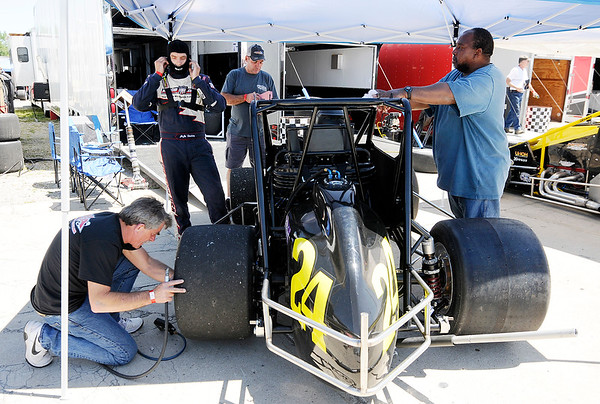 Don Knight   The Herald Bulletin JoJo Helberg prepares for a run on the track as the Spies Racing team makes adjustments to the 24 car during practice for the Little 500 at the Anderson Speedway on Wednesday.
