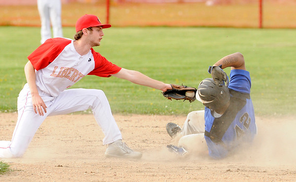 Don Knight | The Herald Bulletin<br /> APA's Khalil Ford beats the tag from Liberty Christian's Isaiah Brees as he steals second on Friday.
